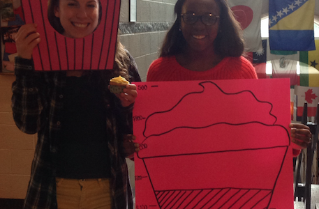 Gabrielle Kolb and Reva Useh promoting cupcake sales for She's the First.
