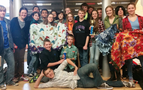 Prep teams holding their trophies and the the 4 tie-blankets that the team made together in between rounds for Regans'